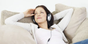 Woman Listening to Podcasts recommended by The Unchargeables